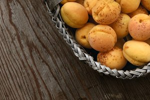Full basket with ripe apricots
