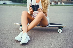 young girl make photo vintage camera