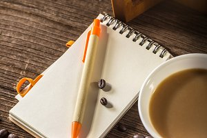 notebook with cup of coffee