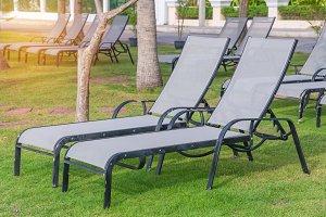Empty sunbeds on park