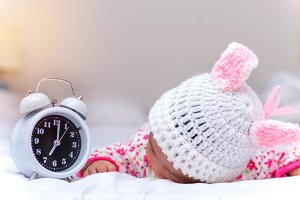 baby and alarm clock wake up