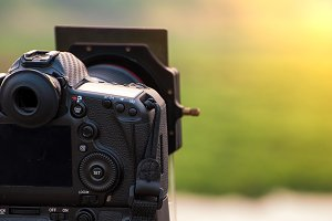 Photographer, DSLR camera close up