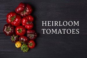Heirloom tomatoes on black