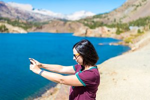 Woman take photo on lake in Yosemite National Park