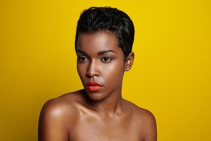 black woman on a bright yellow