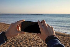 Mockup with phone on beach