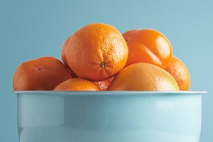 Citruses in bowl isolated