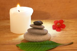 Spa concept with candle, zen stones