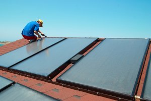 Worker mounting solar panels