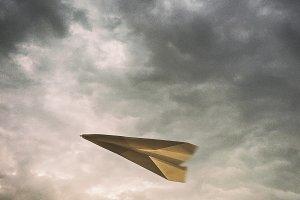 Paper Airplane Soars through the Air