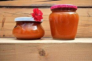 jars of homemade jam and carnation