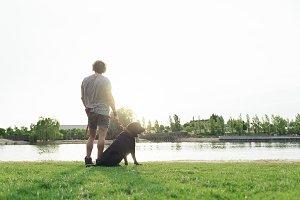Man having fun with his dog.