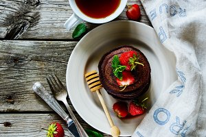 Chocolate pancakes with strawberries