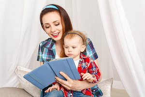 Mother and daughter reading ebook