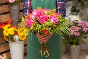 Florist holding roses bouquet