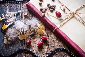 book with earrings and nuts