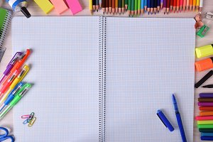 Open notebook and school tool around
