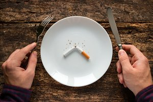 white plate with a cigarette