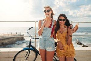 Female friends with a bike