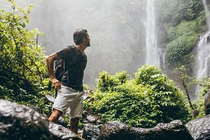 Male hiker near waterfall