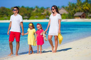 Young family having fun on beach