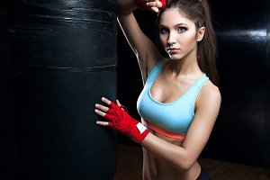 fitness woman with the red boxing bandages