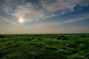 Sun above landscape
