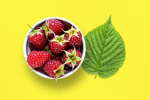 Raspberry and green leaf