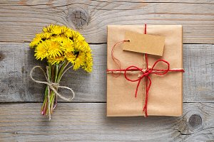 Dandelion flowers and gift box