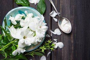 White flowers of jasmine on wood