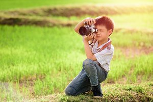 asian boy with classic camera