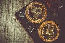 Cognac in glasses on rustic backgrpund