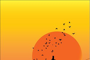 city with birds in sunset sky