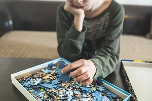 Child and puzzle
