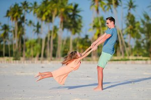 Little girl and father during tropical beach vacation