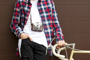 boy with the bicycle and the old camera