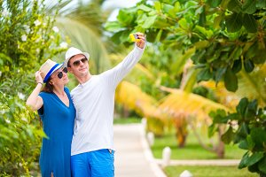Happy couple making selfie relaxing on summer vacation