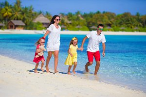 Happy family vacation fun on beach
