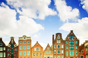 medieval houses over  canal water in Amsterdam