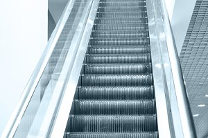 Empty escalator steps on staircase