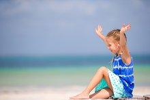 Little adorable girl listening music background sea