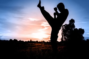Silhouette of man practicing yoga