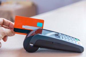 Hand Swiping Credit Card on POS