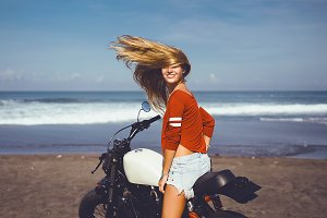 pretty woman using retro motorcycle