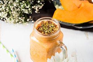 Helathy pumpkin smoothie on table