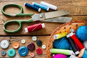 scissors, needle and thread