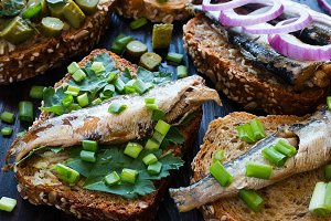 sprats on bread with parsley