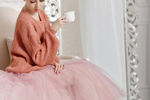 Ballerina drinking coffee