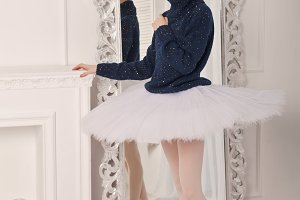 Ballerina in a sweater and a tutu