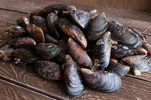 fresh mussels on a wooden table